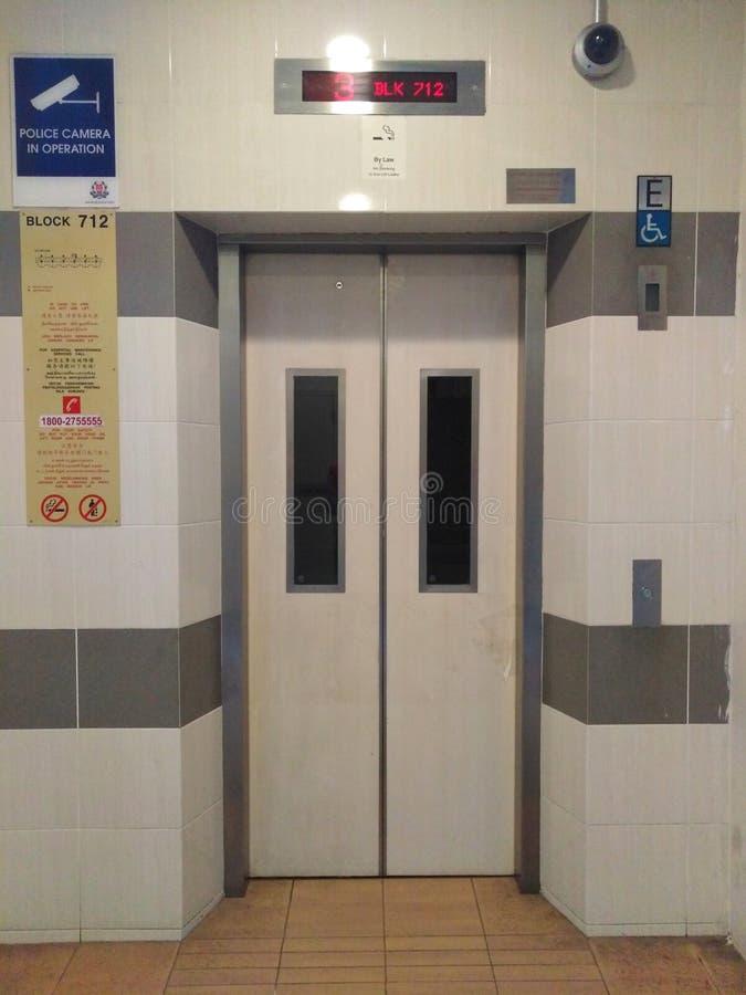 Modern lift lobby in residential block. Modern lift lobby in a residential block in singapore, ground, floor, hdb, flat, apartment, public, housing, estate stock photos