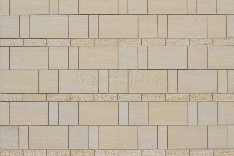 Modern light beige tile wall texture with attractive brick style and pattern royalty free stock photo