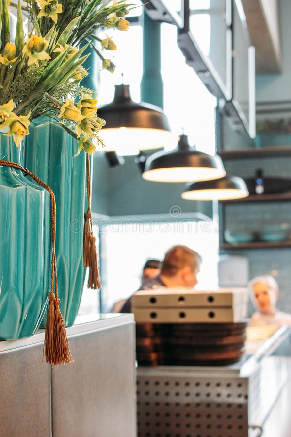 Modern light blue interior of the cafe. Working moments, lifestyle. The Modern light blue interior of the cafe. Working moments, lifestyle royalty free stock photo