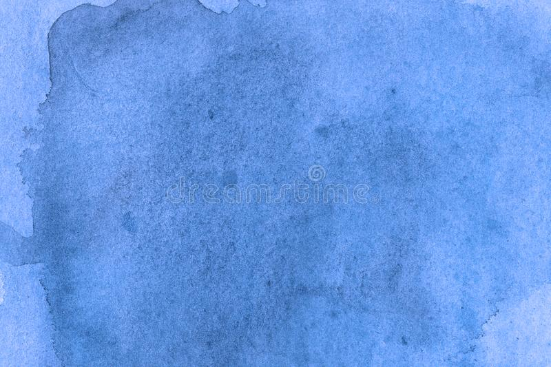 Modern light blue watercolor background texture. The paint splashing on the paper. It is a hand drawn. royalty free stock photography