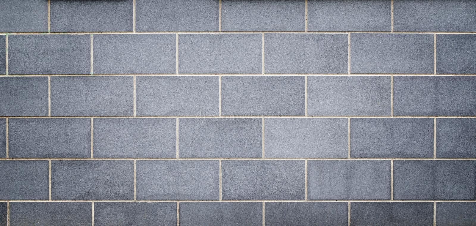 Modern light bluish gray slab wall background. High resolution full frame background of a new, modern and clean wall or building exterior made of light bluish royalty free stock images