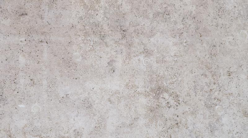 Modern light brown slab wall background. Full frame background of a modern and a bit broken wall or building exterior made of abstract stone slabs royalty free stock photo