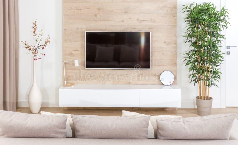 Modern light living room with tv equipment stock images