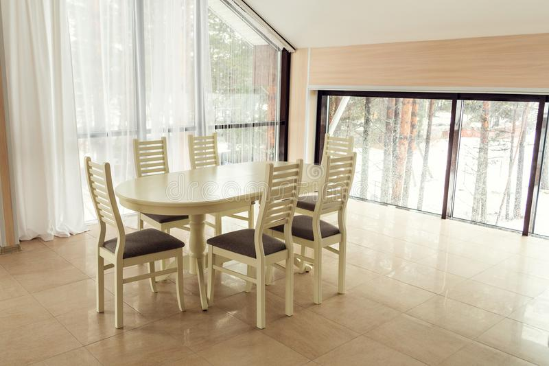 Modern lights apartment with a dining table. royalty free stock photo