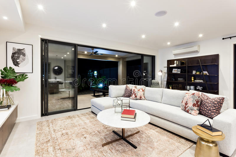 Modern living area with outside patio view at night royalty free stock photos