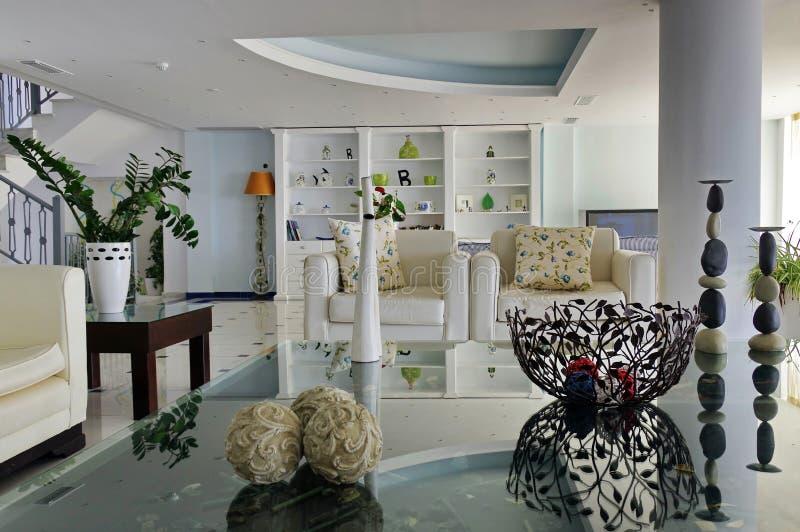 Interior house. Modern luminous white living room stock image