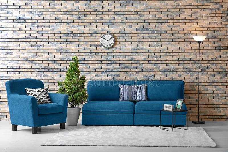 Modern living room interior with comfortable couch stock photo