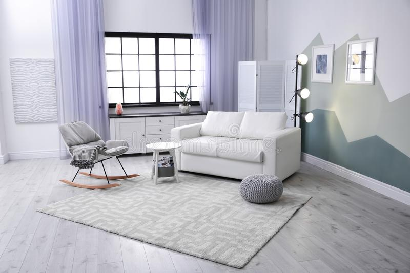 Modern living room interior with comfortable sofa royalty free stock images
