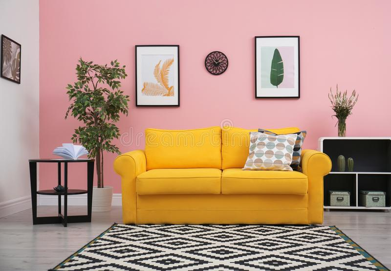 Modern living room interior with comfortable yellow sofa royalty free stock photo