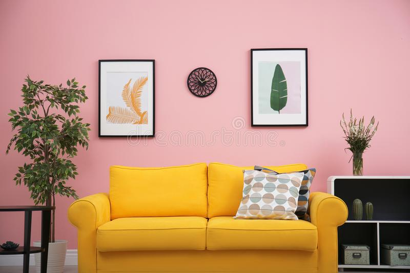 Modern living room interior with comfortable yellow sofa royalty free stock images