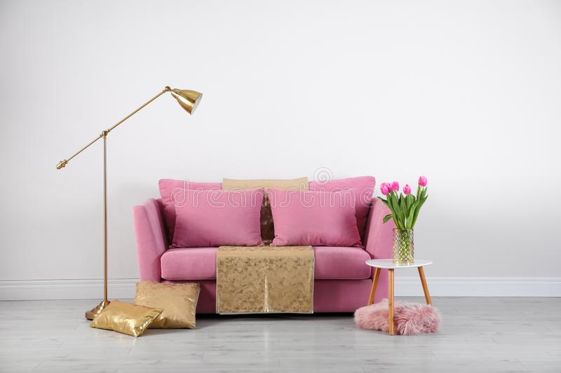 Modern living room interior with stylish pink sofa stock images