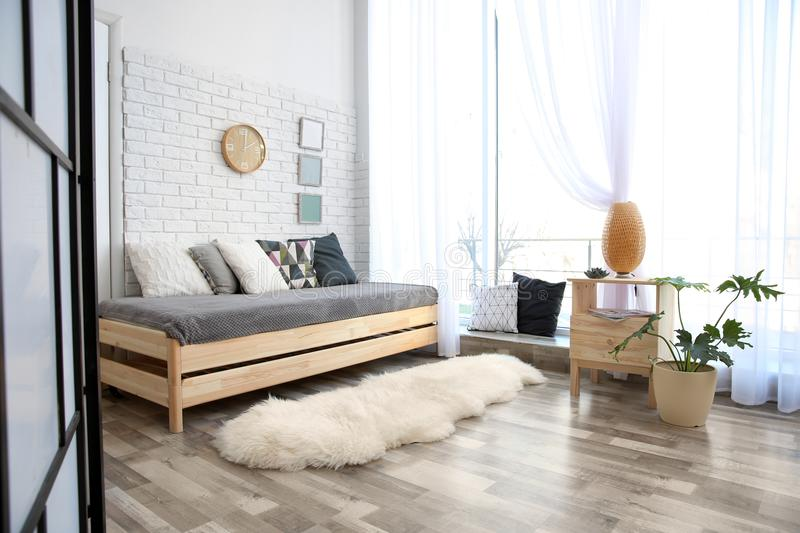 Modern living room interior with wooden furniture royalty free stock photos
