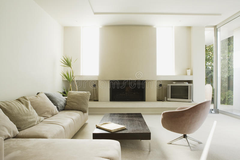 Modern living room. A large modern living room with luxury sofa set royalty free stock images