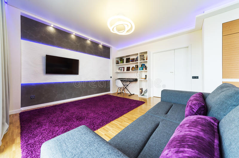 A modern living room with night light. stock photography