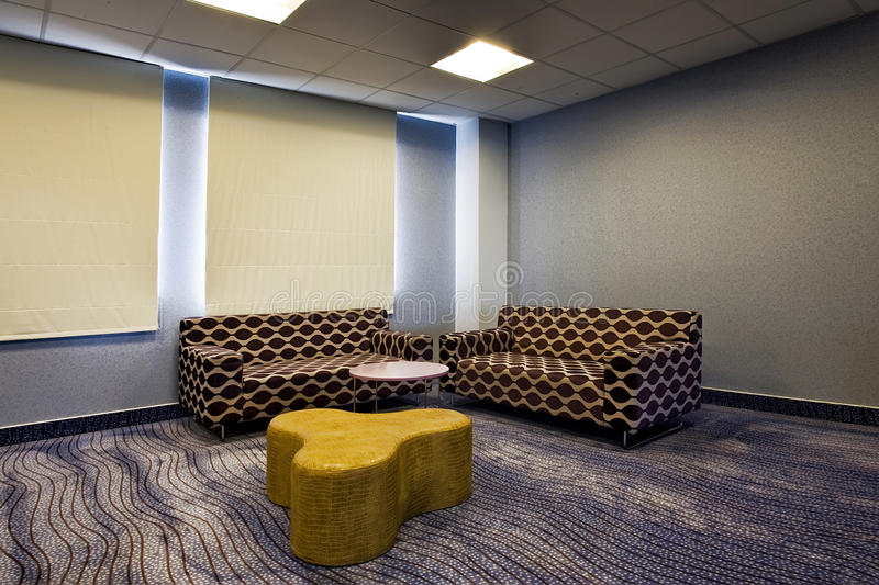 Modern living room with two sofas stock photography