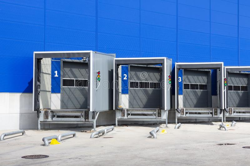 Modern logistics center. Loading dock at a warehouse. docking stations of a distribution center. Modern logistics center. Loading dock at a warehouse. docking stock photography