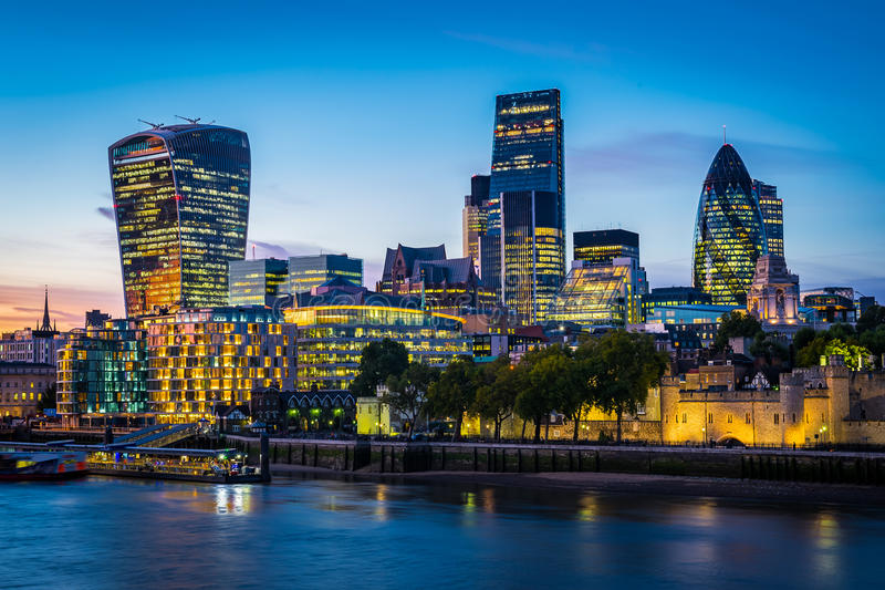 Modern London cityscape in night stock photography