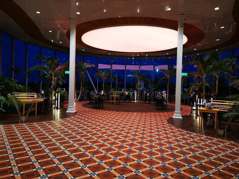Modern lounge bar night at Therme Bucharest, Romania. Palm trees and modern furniture stock photography