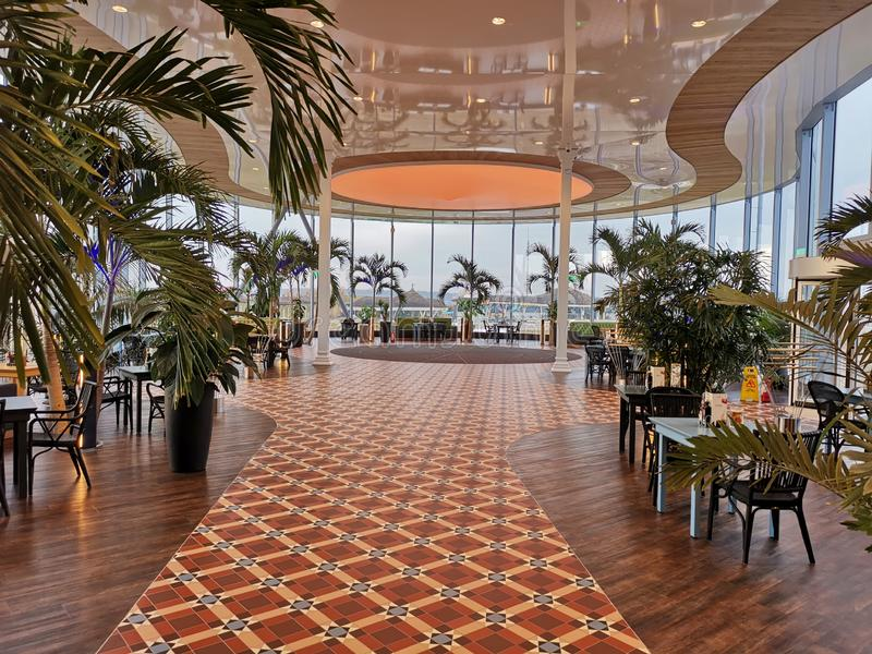 Modern lounge bar at Therme Bucharest, Romania. Palm trees and modern furniture stock photo