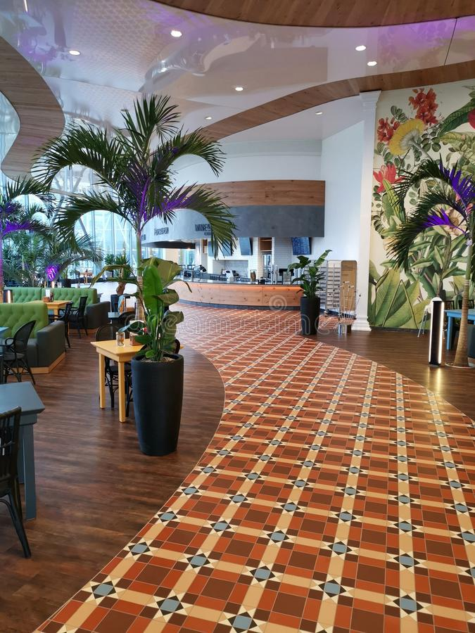 Modern lounge bar at Therme Bucharest, Romania. Palm trees and modern furniture royalty free stock photography