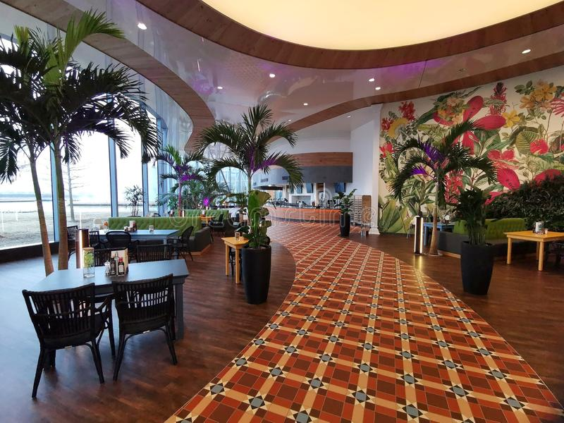 Modern lounge bar at Therme Bucharest, Romania. Palm trees and modern furniture stock photography