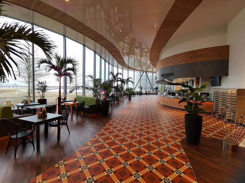 Modern lounge bar at Therme Bucharest, Romania. Palm trees and modern furniture royalty free stock image