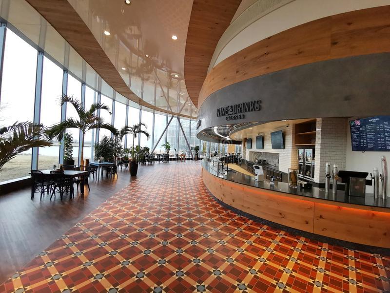 Modern lounge bar at Therme Bucharest, Romania. Palm trees and modern furniture stock images