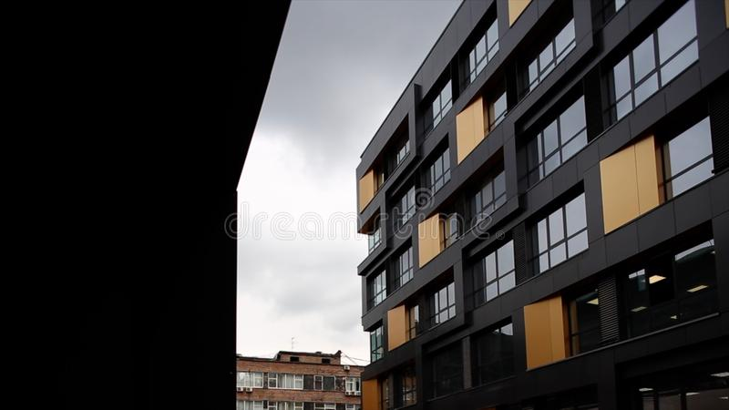 Modern, Luxury Apartment Building against blue sky. Footage. Modern office building. P royalty free stock image