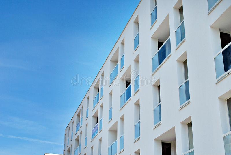 Modern, Luxury Apartment Building. House building and city construction concept: evening outdoor urban view of modern real estate homes royalty free stock photos