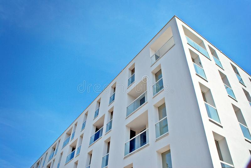 Modern, Luxury Apartment Building. House building and city construction concept: evening outdoor urban view of modern real estate homes royalty free stock photo