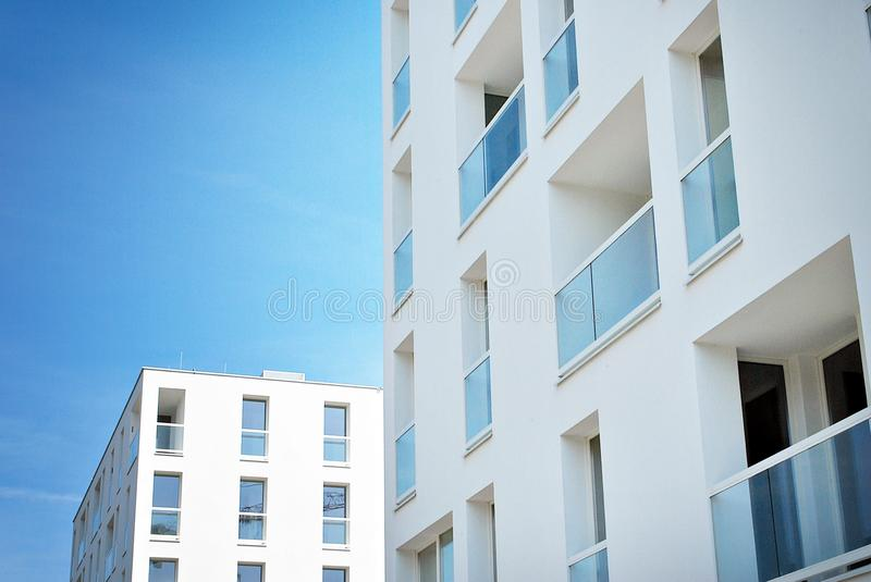Modern, Luxury Apartment Building. House building and city construction concept: evening outdoor urban view of modern real estate homes royalty free stock photography
