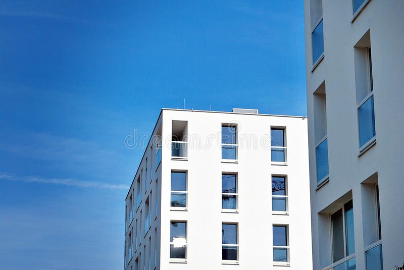 Modern, Luxury Apartment Building. House building and city construction concept: evening outdoor urban view of modern real estate homes royalty free stock image