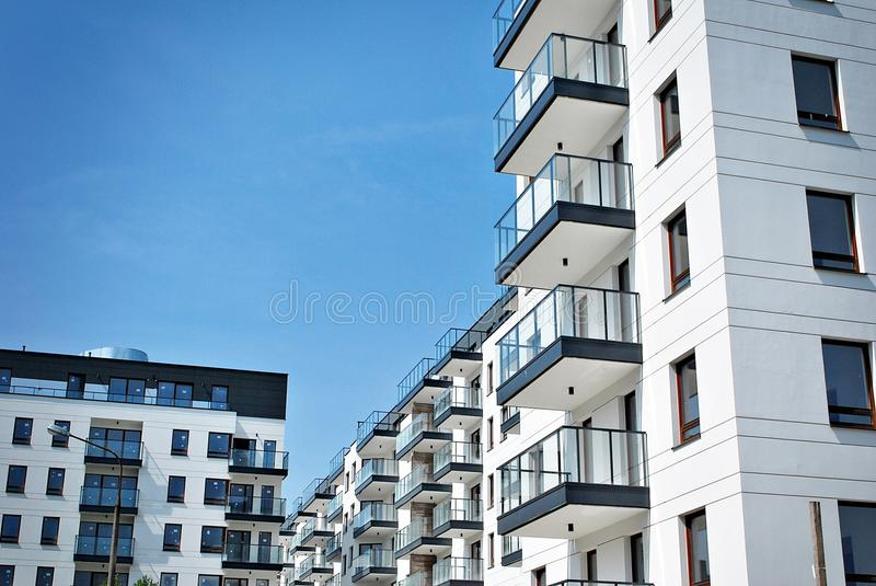 Modern, Luxury Apartment Building. House building and city construction concept: evening outdoor urban view of modern real estate homes stock image