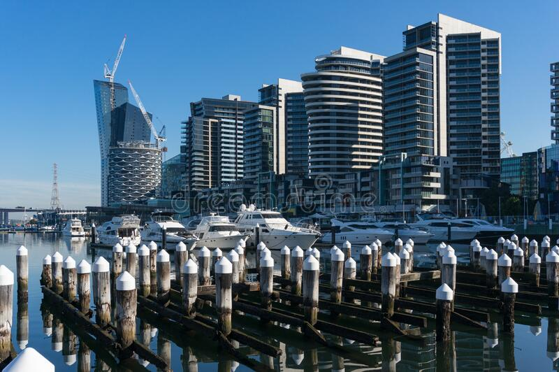 Modern luxury apartment buildings and yachts and boats in Docklands. Suburb of Melbourne, Australia stock photos