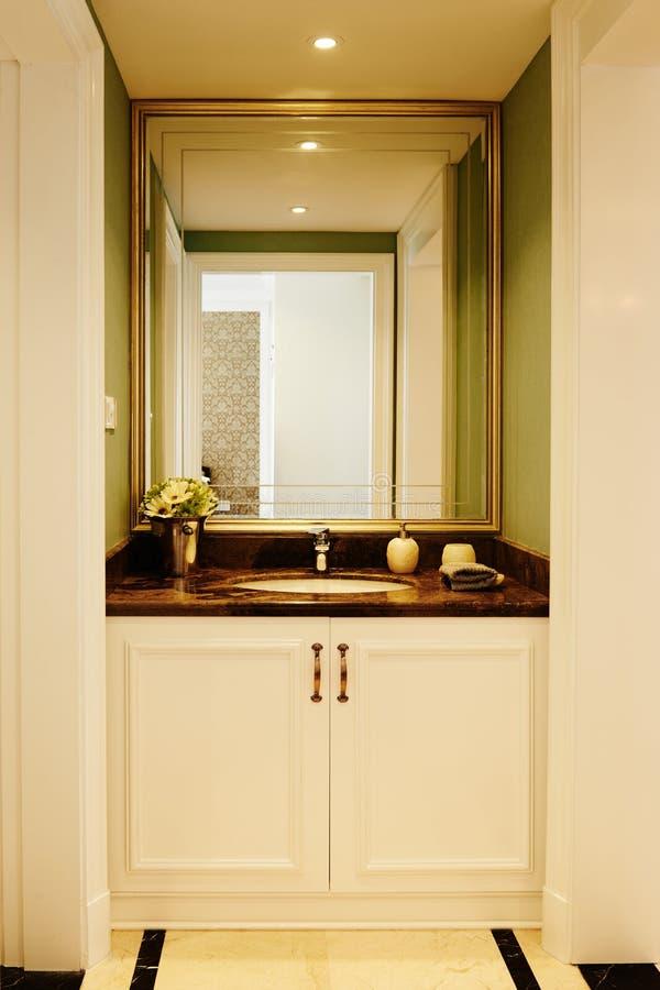 Modern luxury washroom bathroom. Modern luxury washroom with big mirror in european style royalty free stock photo
