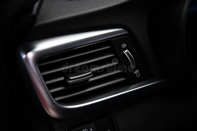 Modern luxury car air vents. Vehicle air condition and ventilation royalty free stock image