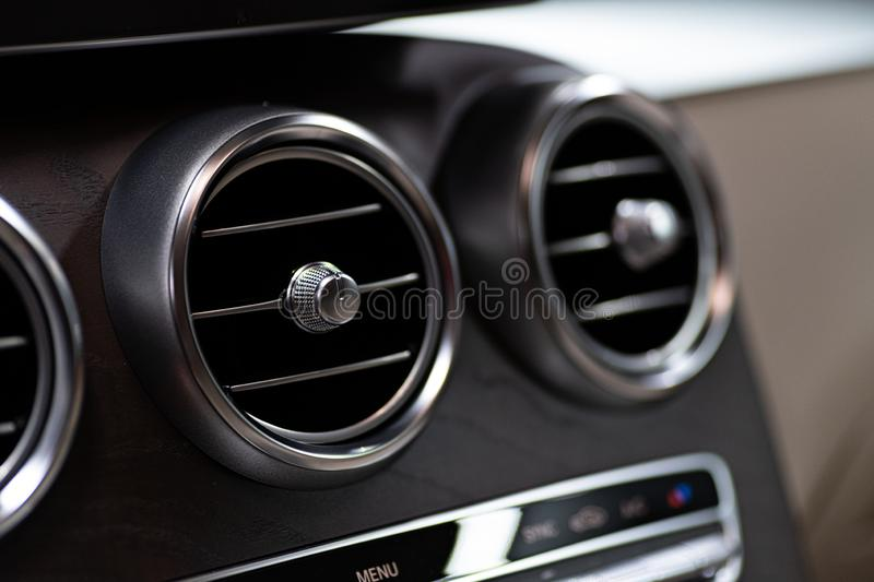Modern luxury car air vents. Vehicle air condition and ventilation royalty free stock photo