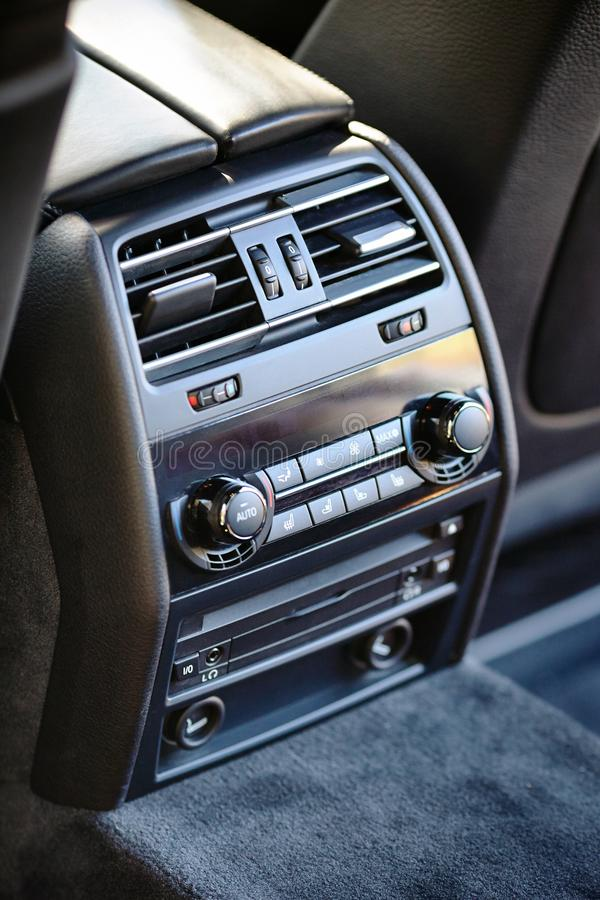 Modern luxury car climate control panel for passengers in the re royalty free stock image