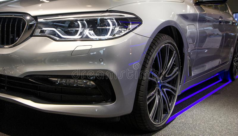 Modern luxury car, headlights closeup. Concept of expensive, sports auto. stock photography