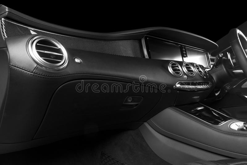 Modern Luxury car inside. Interior of a modern car. Comfortable leather seats. Perforated leather cockpit. Steering wheel and dash royalty free stock images
