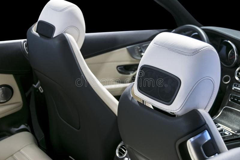 Modern Luxury car inside. Interior of prestige car. Comfortable white perforated leather seats. and cockpit. Steering wheel. And dashboard. Modern car interior royalty free stock images