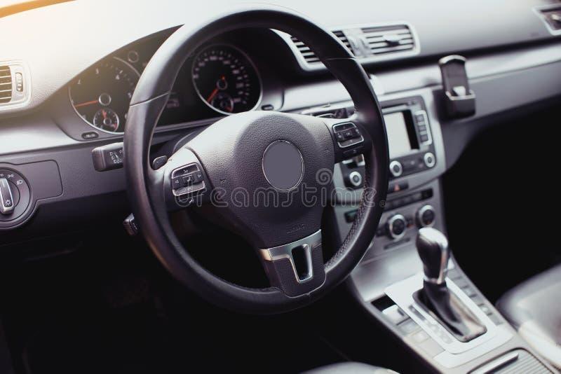 Modern luxury car Interior - steering wheel, shift lever and dashboard. Car interior luxury inside. Steering wheel, dashboard, spe. Edometer, display royalty free stock photo