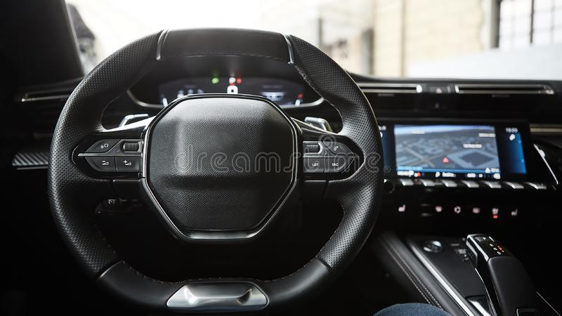 Modern luxury car Interior - steering wheel, shift lever and dashboard. Car interior luxury inside. Steering wheel. Dashboard, speedometer, display. Black royalty free stock photo