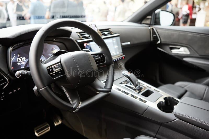 Modern luxury car Interior - steering wheel, shift lever and dashboard. Car interior luxury inside. Steering wheel. Dashboard, speedometer, display. Black stock photo