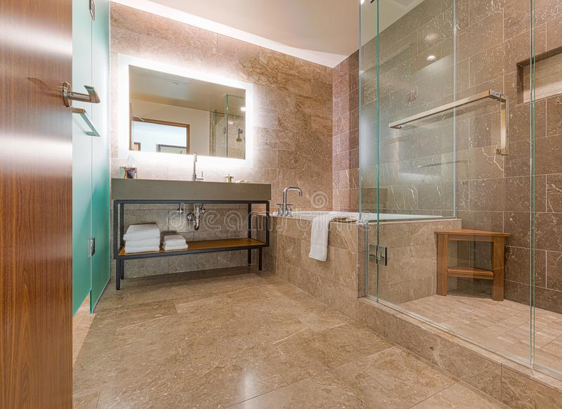 Modern Luxury Contemporary Marble Tiled Bathroom stock photography