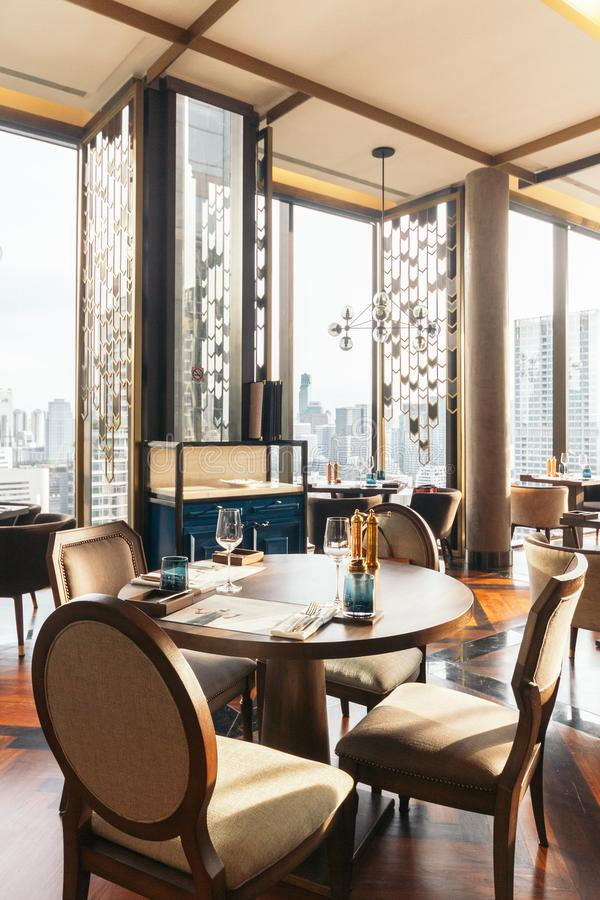 Modern luxury decorated interior restaurant that can view Bangkok cityscape. Elegant design for fine dining stock photography