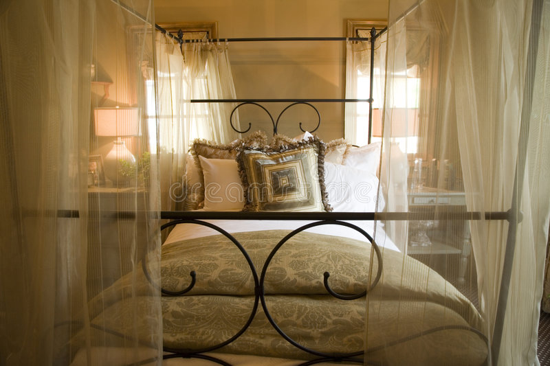 Modern luxury home bedroom. Luxury home bedroom with stylish furniture and decor stock images