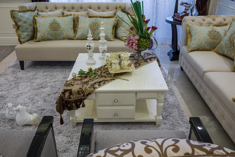 Modern luxury interior home design teapoy sofa parlor living room villa stock photo