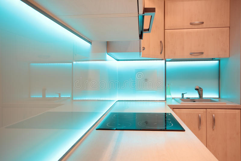Modern luxury kitchen with blue LED lighting.  stock photos
