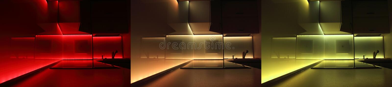 Modern luxury kitchen with led lighting. A night-time view of a modern luxury kitchen in an exclusive new home. Kitchen with LED lighting stock images